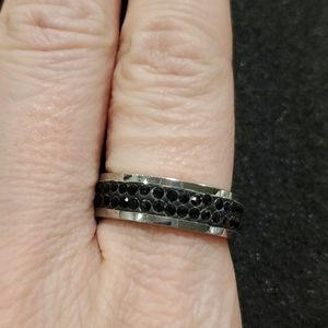 Silver tone ring with black beads